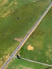 This aerial photo provided by the Oregon State Police shows a 15-mile traffic jam on Highway 26 heading in to Prineville, Ore. on Aug. 17, 2017.