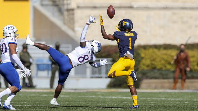 West Virginia wide receiver T.J. Simmons, right, catches a pass over Kansas cornerback Kyle Mayberry during the first quarter of Saturday's game in Morgantown, W.Va. The Mountaineers scored 38 unanswered points en route to a 38-10 victory over the Jayhawks.