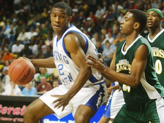Tyler Crawford works against Greensville County's Marcell Powell during the 2004 VHSL State Basketball Championships at the Stuart C. Siegel Center in Richmond Saturday.