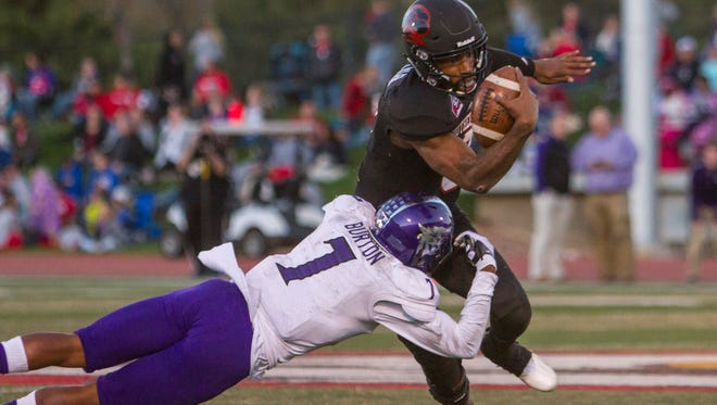 Weber State safety Josh Burton (7) tackles Southern Utah quarterback Patrick Tyler (3) during the first quarter of Saturday's game in Cedar City, Oct. 22, 2016.