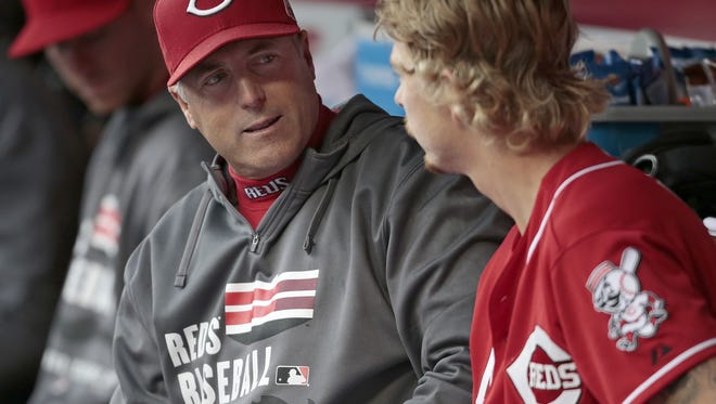 Reds manager Bryan Price talks with pitcher John Lamb during the team's final home game of the season, a 5-3 loss to the Cubs.