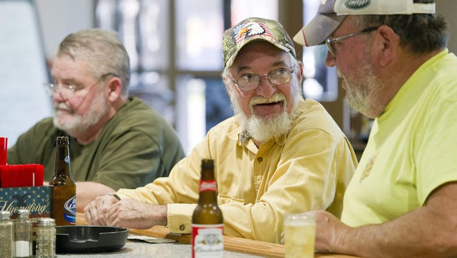American Legion Post 237 member and U.S. Army veteran Harold Peru, center, of Union City, chats with friend Dave Shreve, 64, of Bloomfield Township, Crawford County, as they hang out recently at the post's bar with post member Jerry Lesik, 65, left, of Union City, at the post in Union Township, near Erie, Pa.