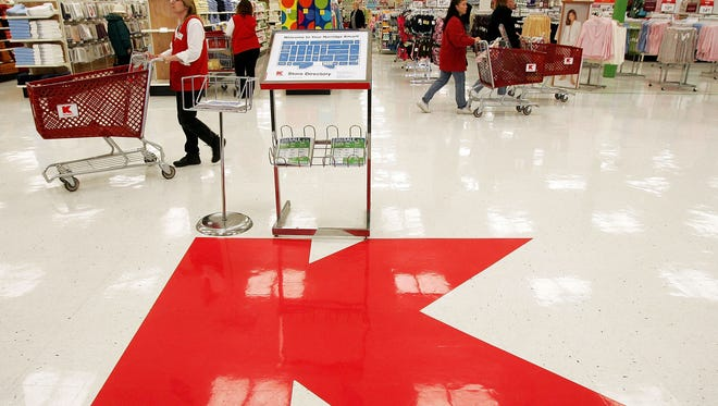 A large Kmart logo sits on the floor of a newly revamped Kmart store April 22, 2005 in Norridge, Illinois.