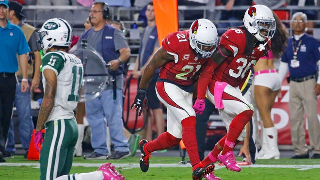 Arizona Cardinals cornerback Patrick Peterson (21) and defensive back D.J. Swearinger (36) cerebrate after Swearinger's interception against the New York Jets on Monday, Oct. 17, 2016 in Glendale, Ariz.