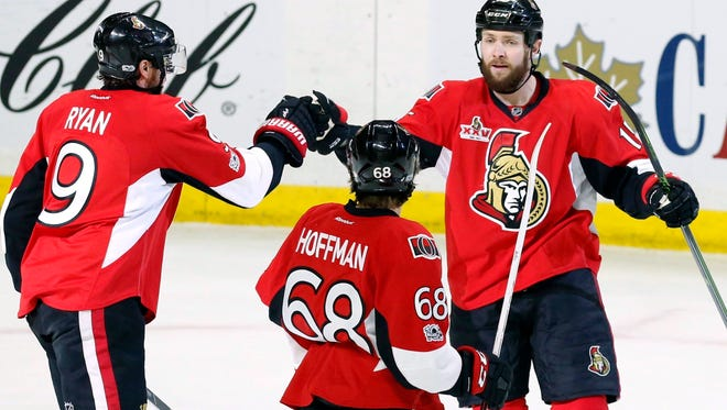 Ottawa Senators right wing Bobby Ryan (9) celebrates his goal against the Buffalo Sabres with center Zack Smith (15) and left wing Mike Hoffman (68) during the first period of a game Tuesday in Ottawa.