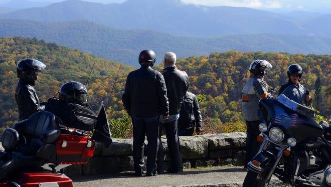 Fall colors on the Blue Ridge Parkway between Mt. Pisgah and Waterrock Knob. This group of motorcyclists were at East Fork Overlook near Graveyard Fields in 2013.