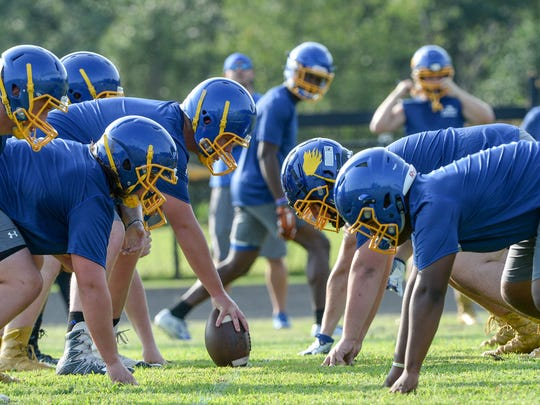 Wren High School football players line up for a play during a practice at the school in Piedmont in July.