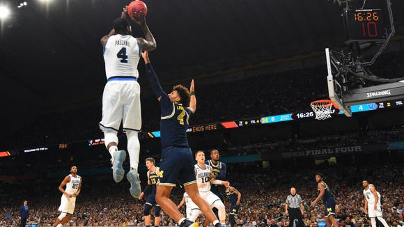 Villanova Wildcats forward Eric Paschall (4) shoots as Michigan Wolverines forward Isaiah Livers (4) defends during the first half in the championship game of the 2018 men's Final Four at Alamodome.