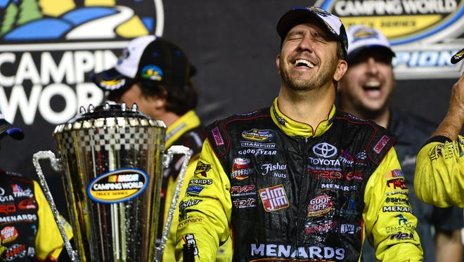 Matt Crafton celebrates his second consecutive NASCAR Camping World Truck Series championship in November. He'll be one of the favorites Friday at Iowa Speedway.
