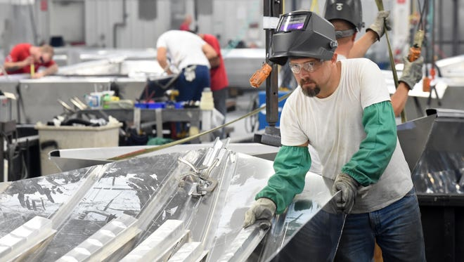 Mike Tiller is among five former Epoxyn employees who have landed on their feet with jobs at Ranger Boats in Flippin.