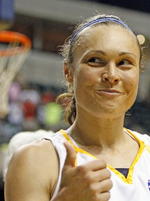 Tully Bevilaqua gives fans the thumbs up as she walks off the court. The Indiana Fever hosted the Connecticut Sun in WNBA action at Conseco Fieldhouse Sunday 6/13/10. Rob Goebel/Indianapolis Star.