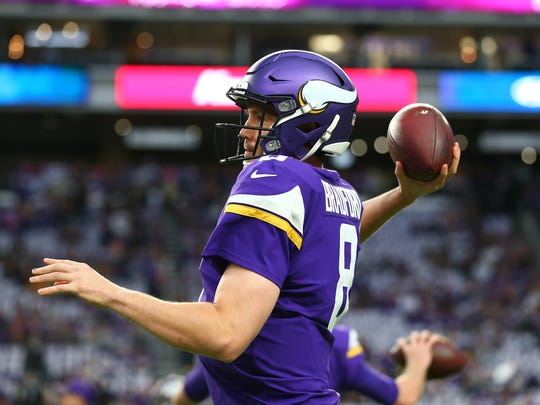Sam Bradford warms up before the Vikings' divisional playoff game in January.