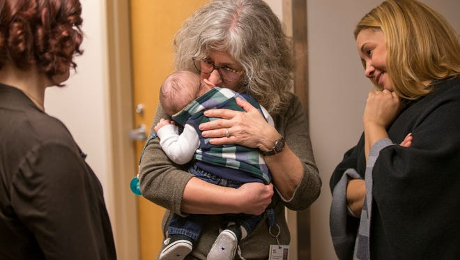Kristen Cebada (left) and her son, Junah, visit with nurse Bizz Grimes (center) and Dr. Tara Benjamin at IU Health University Hospital Thursday, Nov. 16, 2017. Cebada, a former heroin user, sought treatment as she was using during the first months of her pregnancy.