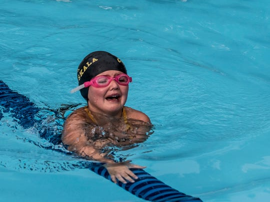 Belle Lauvray, overcame her fear and finished her first swim race, swimming the 25 meter freestyle. The Johnstown-Northridge Jaguars hosted the Pataskala Porpoises in a Tri-County Aquatic League meet Wednesday in Johnstown at the Skate and Swim.