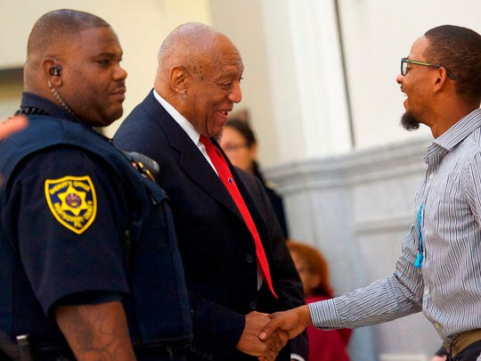 Actor and comedian Bill Cosby, center, is greeted as