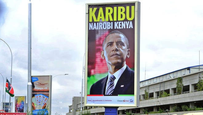 """A banner bearing the likeness of President Obama with a """"welcome"""" message hangs over the arrival lounge of  Kenya's Jomo Kenyatta airport in Nairobi on July 23, 2015."""