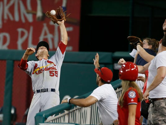 St. Louis Cardinals right fielder Stephen Piscotty (55) catches a foul ball hit by Washington Nationals' Daniel Murphy during the fourth inning of a baseball game at Nationals Park, Saturday, May 28, 2016, in Washington. (AP Photo/Alex Brandon)
