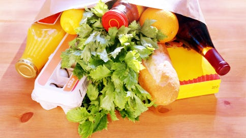 A stock image of a grocery bag full of groceries.
