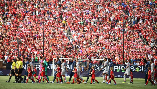 Manchester United and Liverpool make their way onto the field as over 100,000 fans cheer them on at The Big House for Saturday's International Champions Cup match.