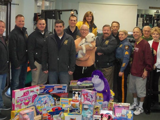 Members of the Long Hill Police Department and Mountain Fitness of Warren with toys collected at the club for the Long Hill PBA's annual Toy Drive on Dec. 22. The toys were distributed to children at Overlook and Morristown medical centers. From left: Sgt. Chris Gelino; Officer Ray Schlaier; Detective R.J. Sutton; Officer Gary Bauer, Toy Drive Director; Officer Brian Engel; Alan Kaufman, Warren; Bonnie Kaufman, Warren; Officer Kris Kisatsky; Robert Senyk, Watchung; Sgt. Dolores LoPresti; Mountain Fitness proprietor Ed Halper, Basking Ridge; Pat Cicala, Watchung; and Ella Cicala, Watchung.