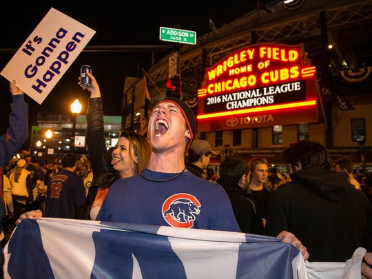 Chicago Cubs fans celebrate outside Wrigley Field after the Cubs beat the Dodgers to clinch the National League pennant.