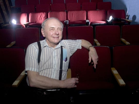 Paul Stapel, former executive director of the Art Mission and Theater, sits in one of the two theaters at the Binghamton location. One has since been named for him.