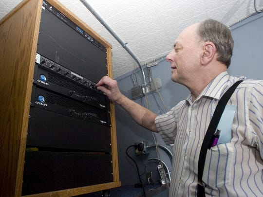 Paul Stapel, former executive director of the Art Mission and Theater, accesses the audio equipment in the film room of the new theater.