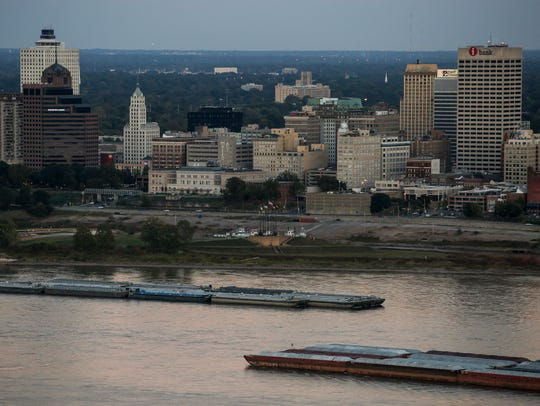 Barges pass each other in front of downtown Memphis on Nov. 9, 2016. Like other neighborhoods across the city, downtown has experienced ups and downs since the sanitation strike and Dr. Martin Luther King Jr.'s assassination in 1968.
