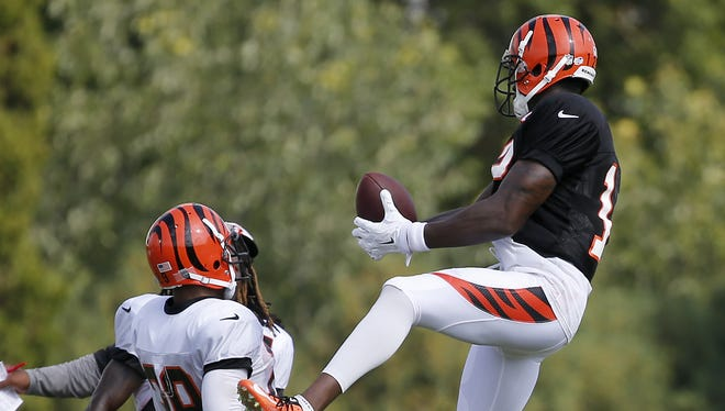 Cincinnati Bengals wide receiver Mohamed Sanu (12) makes one a one-handed catch on the sideline during Cincinnati Bengals training camp, Wednesday, Aug. 19, 2015, on the practice fields adjacent to at Paul Brown Stadium in Cincinnati, Ohio.