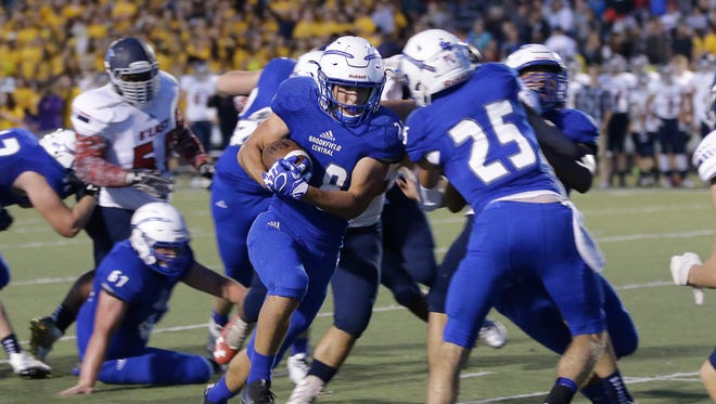 Zach Heckman of Brookfield Central runs the ball down to the one-yard line against Brookfield East.