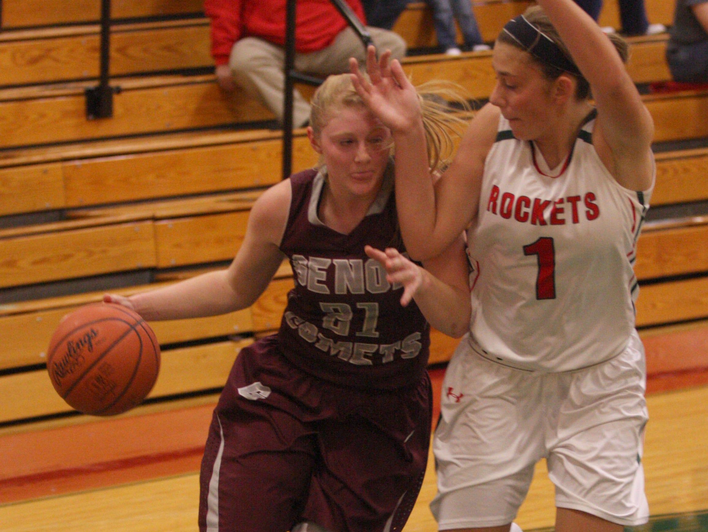 Oak Harbor's Emma Barney, right, defends Genoa's Haley Pickard on Tuesday.