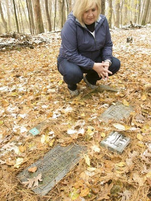 Waterford resident Diane Rousseau visits her cats at a pet cemetery in Genoa Township, Mich., on Friday, Nov. 9, 2018.