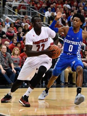 Louisville forward Deng Adel drives to basket against Kentucky guard De'Aaron Fox during their game last week.