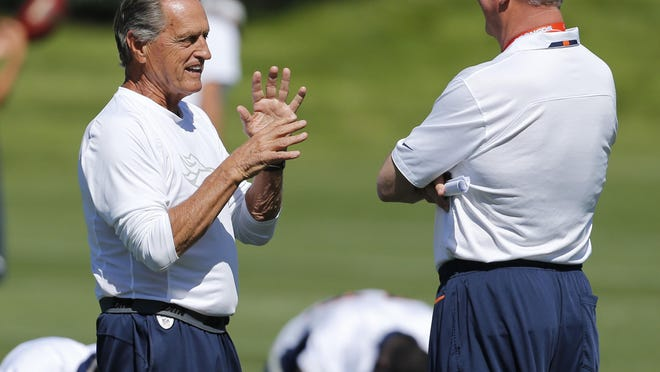 Alex Gibbs, left, a former Broncos offensive line coach who serves as an offensive line consultant for the Denver Broncos talks to head coach John Fox during off season training camp at the NFL football team's training facility in Englewood, Colo., on Thursday, June 6, 2013.