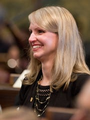 Newly sworn-in state Rep. Julie Calley smiles on Wednesday, Jan. 11, 2017 during the first session of the 99th Legislature in the House of Representatives chamber at the Capitol in downtown Lansing.
