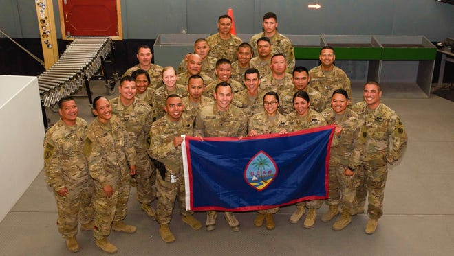 Soldiers assigned to the 368th Military Police Company, Detachment 3, from Guam pose for a photo on Bagram Airfield in Afghanistan, on June 7, 2017. Detachment 3 has been conducting the customs mission on Bagram and Kandahar Airfields. Just about everyone supporting the Resolute Support and Operation FreedomÕs Sentinel mission in Afghanistan has passed the careful inspections of this vigilant team.
