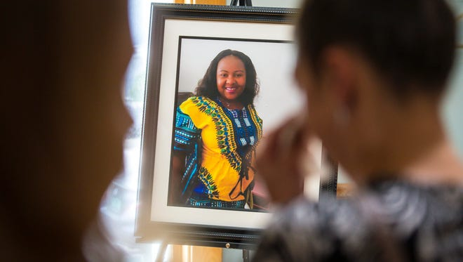 """Mourners gather at the LaVigne Funeral Home in Winooski before funeral services for Anako """"Annette"""" Lumumba on Thursday, May 17, 2018."""