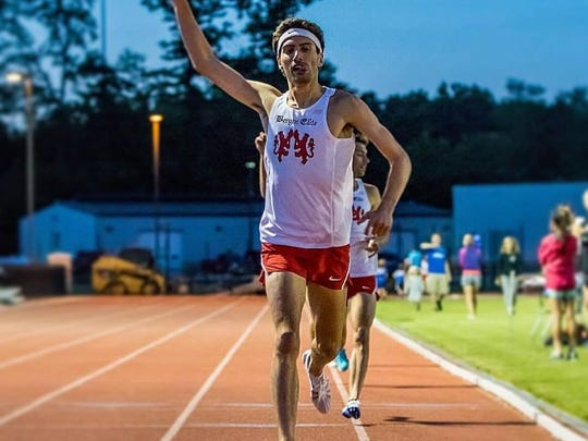 Nick Guarino sprints to the finish of the McMullen Mile, at St. John Fisher College on June 10, 2016. Guarino, 27, of Bergen won the mile-long race in 4:15:15.