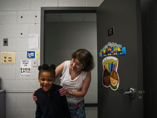 October 12, 2017 - Mary Baer, a teacher at Memphis Heritage Christian School, greets student Madison Williams, 5, following a water break on Thursday. Baer, 65, is a cancer survivor who came to the school seven years ago with a new purpose in teaching children at the struggling school. She often gives up her salary when the school is financially stressed to meet budget.