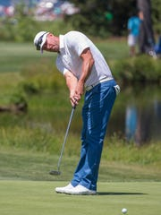 Mark Mulder putts on the tenth green during the American