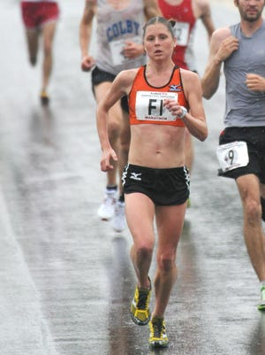 Heidi Westover, 30, of Walpole, NH, heads down Main Street in Burlington Sunday on her way to winning her fifth KeyBank Vermont City Marathon in six years.