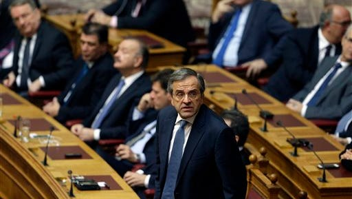 Greece's Prime Minister Antonis Samaras votes during the third round of voting to elect a new Greek president at the Parliament in Athens on Monday, Dec. 29, 2014, as Greece heads to early general elections after parliament failed to elect a new president in a third and final round of voting. The coalition government's candidate for the post, the 73-year-old former European commissioner Stavros Dimas, garnered 168 votes from parliament's 300 seats, short of the 180 votes needed to win. (AP Photo/Thanassis Stavrakis)