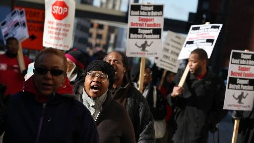 Hundreds of Detroit retirees and city workers marched during Detroit's Chapter 9 bankruptcy hearing in front of the federal courthouse on West Lafayette in Detroit on Wednesday, Oct. 23, 2013.