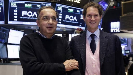 Fiat Chrysler Automobiles CEO Sergio Marchionne, left, and company Chairman John Eikann, pose for photos on the floor the New York Stock Exchange, Monday, Oct. 13, 2014.