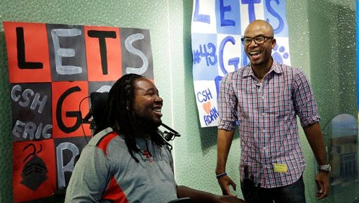 Eric LeGrand, left, alumni of Rutgers University and Adam Taliaferro alumni of Penn State University, college football players who suffered serious spinal cord injuries on the field, cut up as they stand near posters before visiting children at PSE&G Children's Specialized Hospital.Wednesday, Sept. 10, 2014, in New Brunswick, N.J. LeGrand and Taliaferro will be the honorary captains when Rutgers and Penn State meet Saturday at High Point Solutions Stadium in the Big Ten Conference opener in September 2014. Taliaferro, who recovered from a paralyzing spinal-cord injury, is now rising in New Jersey politics.