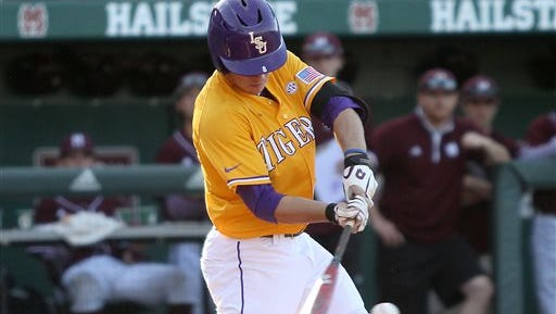 LSU's Alex Bregman (8) gets a hit during an NCAA college baseball game against Mississippi State in Starkville, Miss., Saturday, May. 2, 2015. (AP Photo/Jim Lytle)