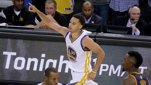 Golden State Warriors guard Stephen Curry (30) reacts during the second half of Game 1 of basketball's NBA Finals against the Cleveland Cavaliers in Oakland, Calif., Thursday, June 4, 2015. (AP Photo/Eric Risberg)