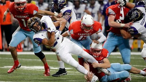 Kearney running back Marcus Harris gains yardage during the second half in the Missouri Class 4 state high school football championship against Webb City Friday, Nov. 27, 2015, in St. Louis. Kearney won 17-14. (AP Photo/Jeff Roberson)