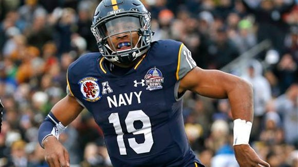 Navy quarterback Keenan Reynolds reacts after scoring a touchdown in the first half of the Military Bowl NCAA college football game against Pittsburgh, Monday, Dec. 28, 2015, in College Park, Md. (AP Photo/Patrick Semansky)