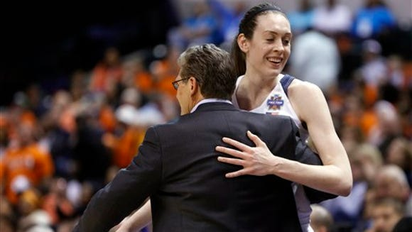 Connecticut's Breanna Stewart (30) is greeted by head